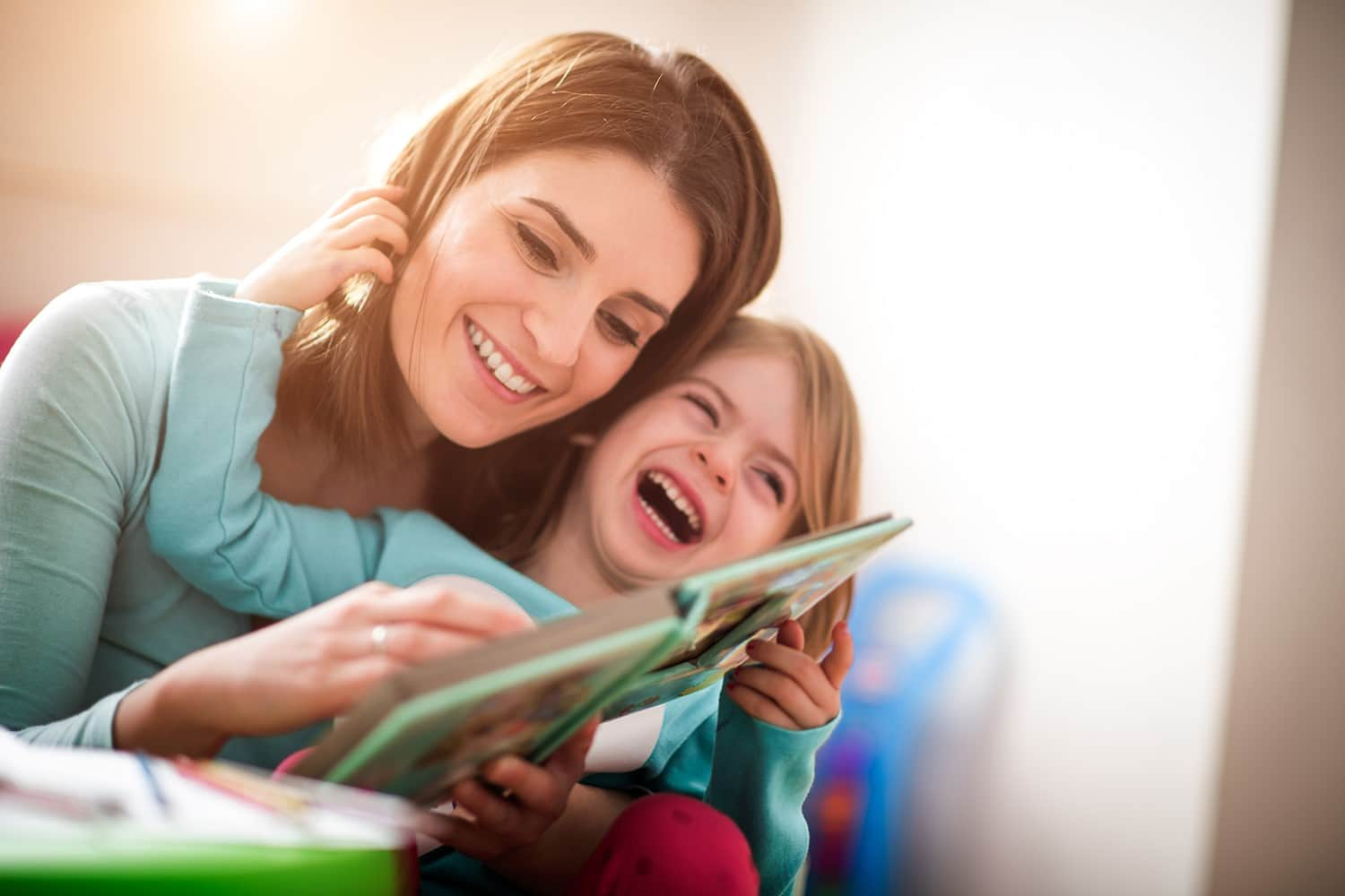 Child and parent reading at bedtime
